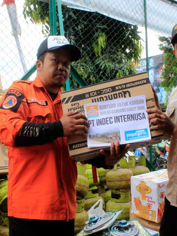 Bantuan dari PT Indec Internusa. Laporan Penyaluran dan Penggunaan Dana Bantuan Korban Banjir Bandang Garut